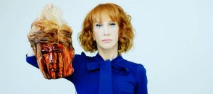 Kathy Griffin poses for picture with Trump head.